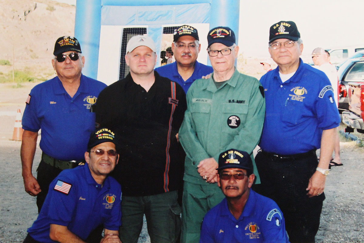 Miguel Fernandez (center) with members of the Vietnam Veterans of America Wieland C. Norris Chapter 844. (David A. Reyes/Borderzine.com)