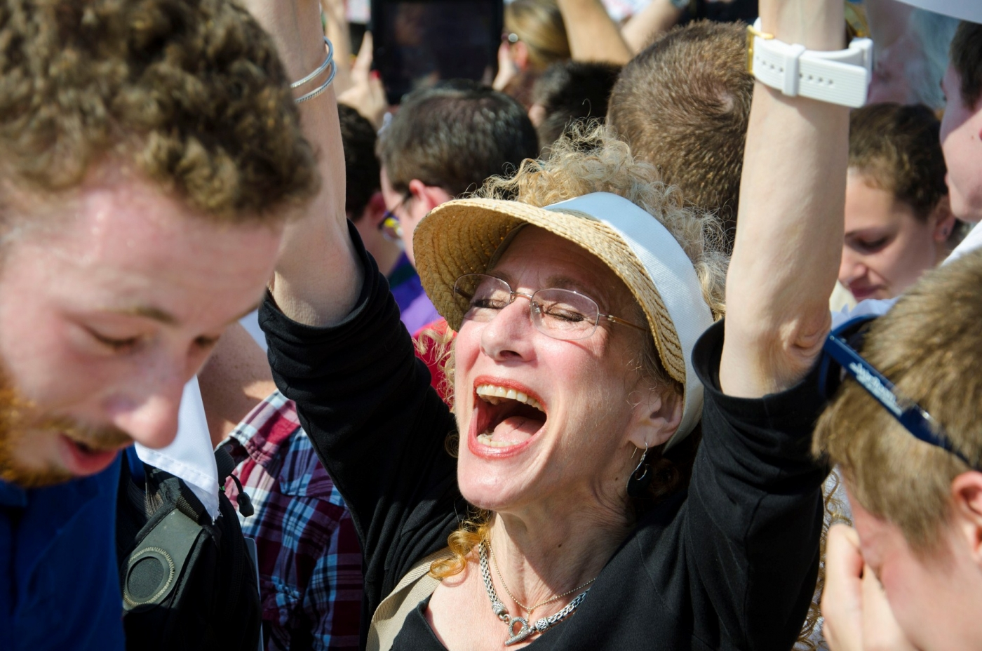 "Sharon Solomon, 60, of Los Angeles, cheers outside the Supreme Court on Wednesday as word traveled of the justice's ruling that the Defense of Marriage Act is unconstitutional. ""I'm jubilant,"" she said. ""This is the beginning of the next step of a continuing journey."" SHFWire photo by Deanna Del Ciello"