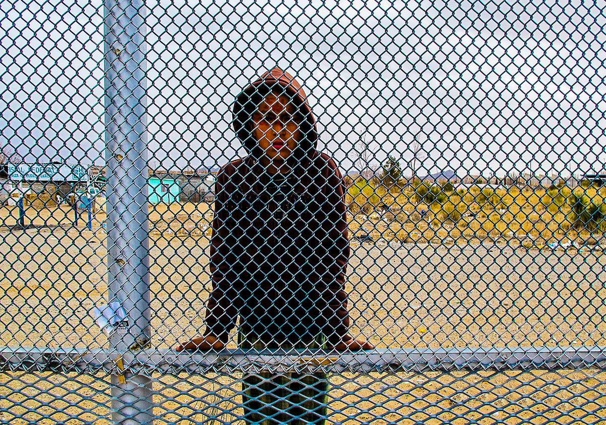 boy at border fence