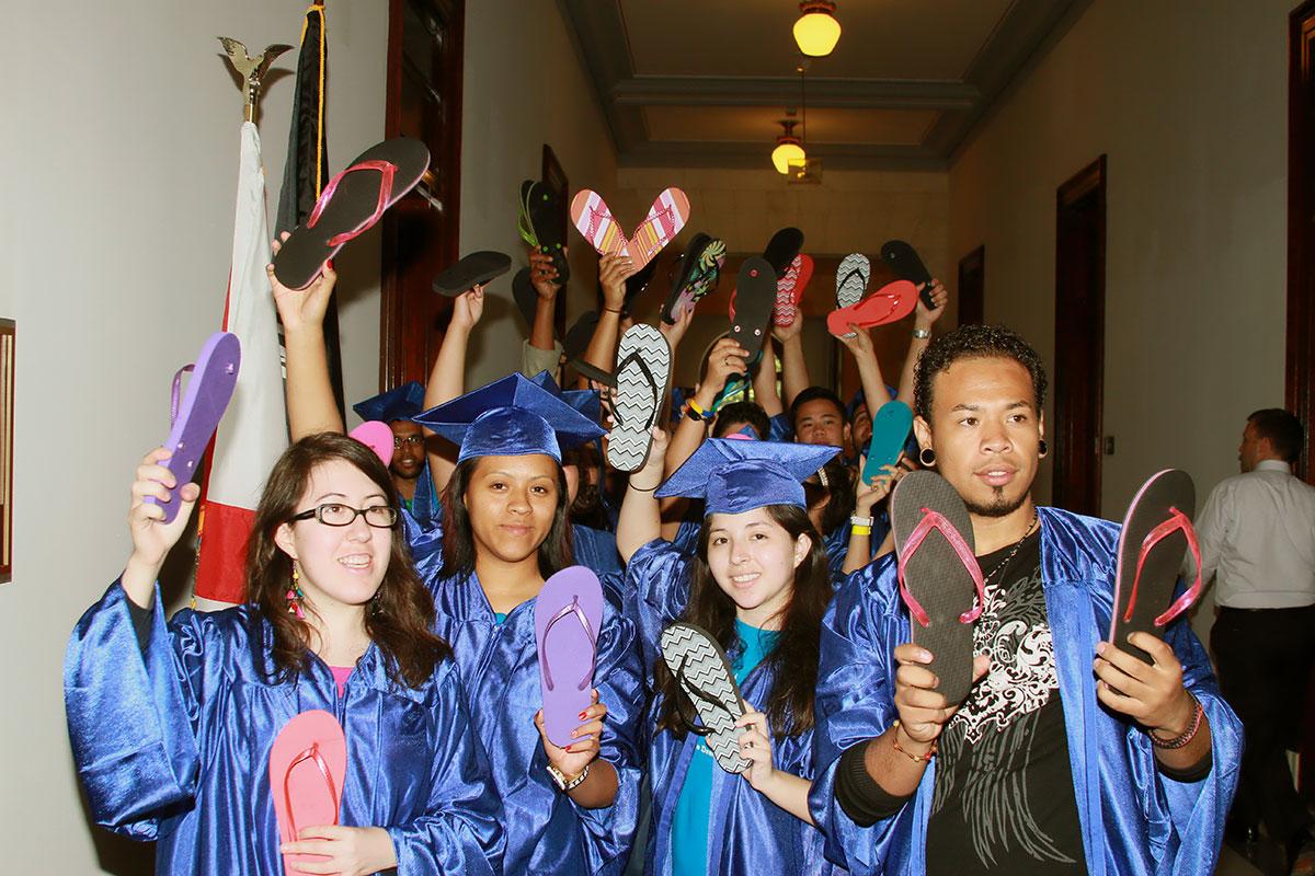 "DREAMers deliver flip-flops or chanclas to ""misbehaved"" senators. (Luis Hernandez/Borderzine.com)"