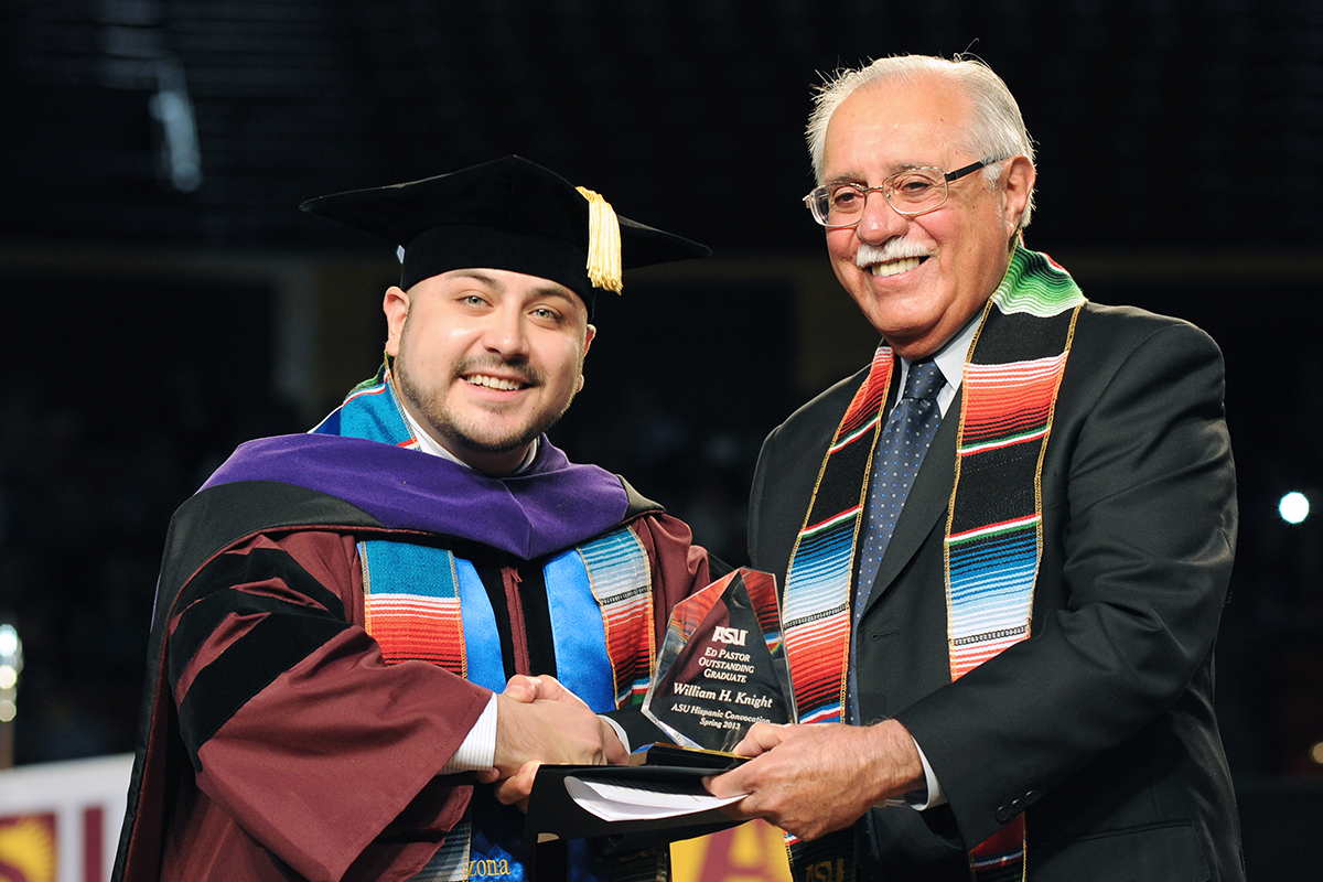 Graduating Latino student, William Knight receiving an award at ASU's ceremony. (Tim Trumble/Hispanic Link)