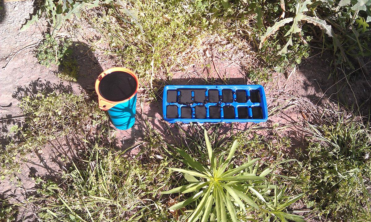 Orgonite molds curing in the sun. (Sarah Duenas/Borderzine.com)