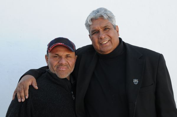 Pastor José Antonio Galván (right) with patient Josué Rosales, who helps him operate the asylum. (Courtesy of Morgan Smith)