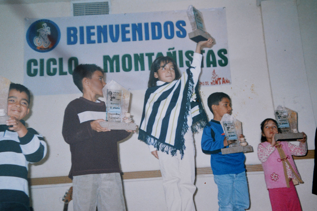 """Fernanda Polanco proudly holds her fist place plaque in the 2005 Mountain Race State Championship. """"She had to drop the mountain cycling team because the boys would bother her for being the only girl,"""" her mother said. (Courtesy of Fernanda Polanco)"""