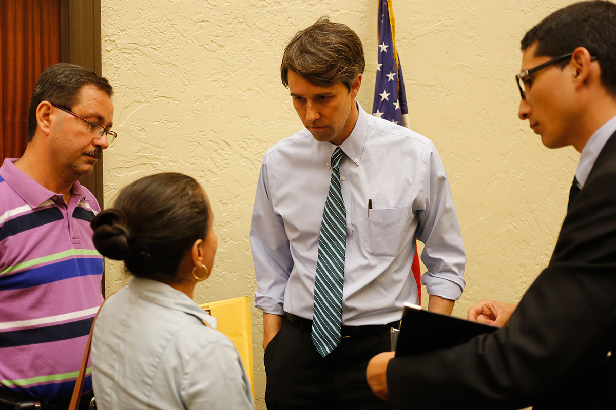 Maria Espinoza talks to Congressman Beto O'Rourke (D-Texas) about her concerns about U.S. military intervention in Syria after the town hall meeting on Sept. 2 at the Mills building in Downtown El Paso. (Aaron Montes/Borderzine)