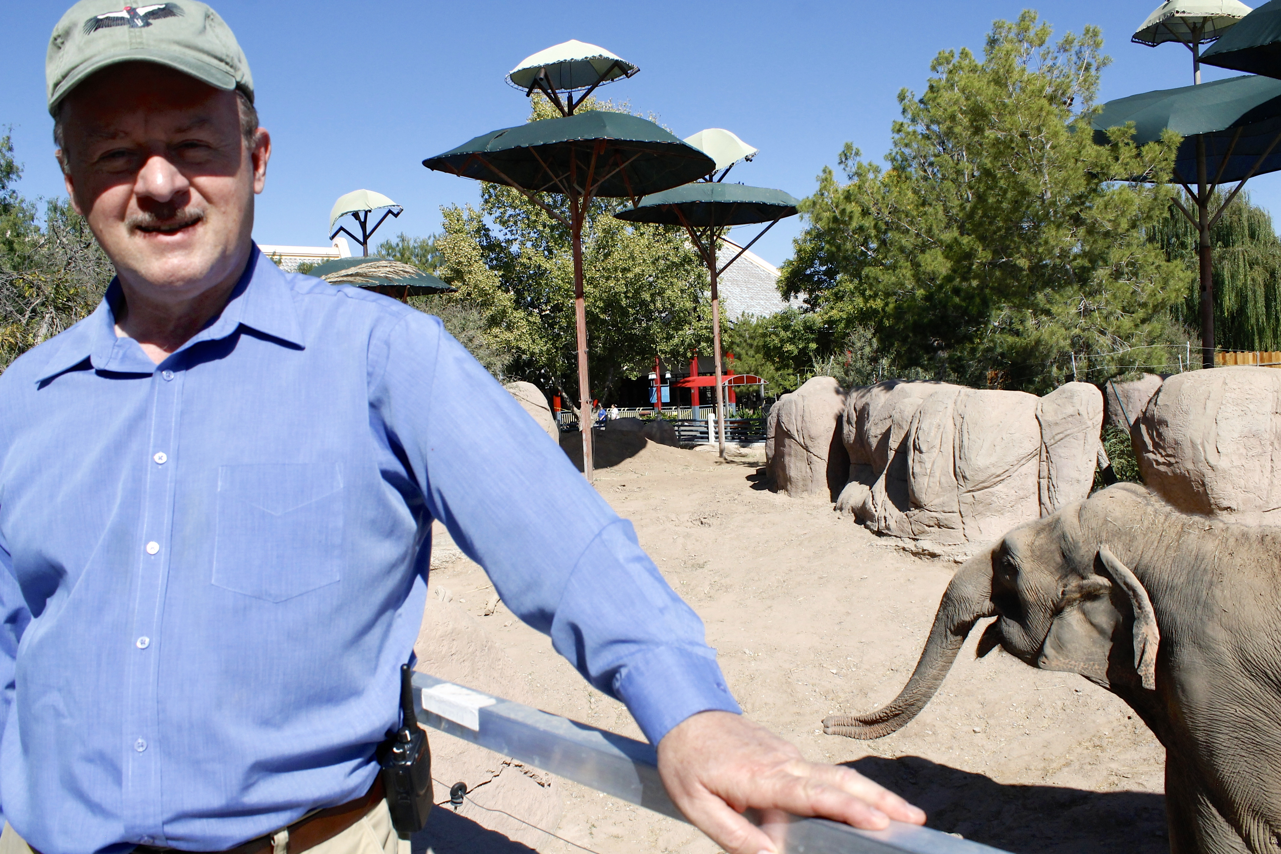 As the El Paso Zoo's education curator, Rick LoBello, 60, tries to bring together young visitors and animals. (Lucia Quinonez / Borderzine.com)