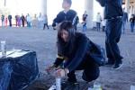 Beatriz Salazar lits a candle before the prayer commemorating the immigrants who died crossing the border. (Edwin Delgado/Borderzine.com)