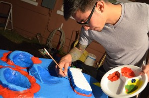 "Artist Diego Garcia works on a ""Día de los Muertos"" mask for an upcoming gallery opening.(Valeria Hernandez/Borderzine.com)"