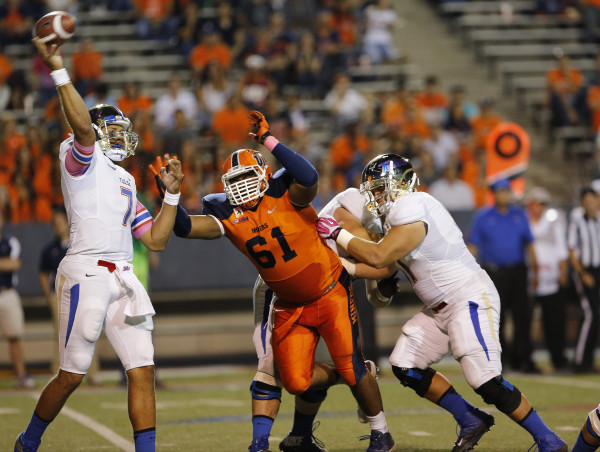 I jump through two offensive linemen to hit the quarterback at a game against Tulsa. (Ivan Pierre Aguirre, courtesy of UTEP Athletics)