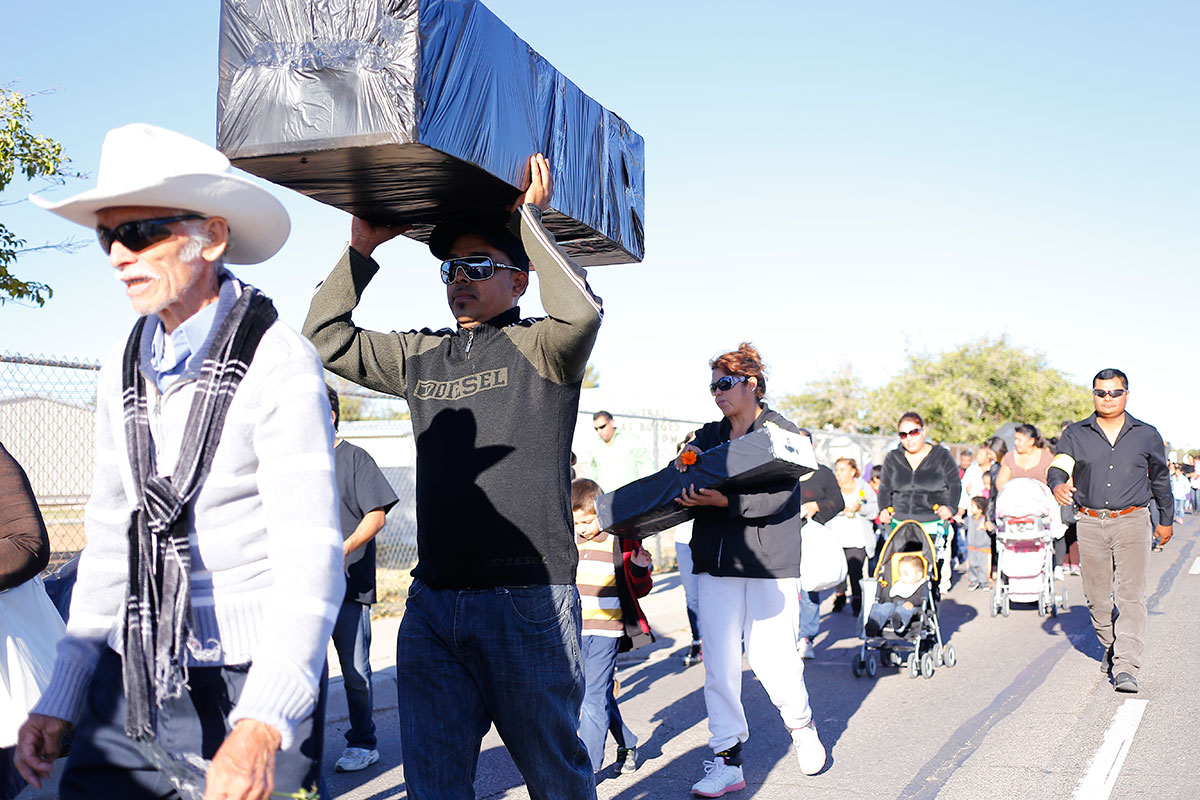 Juan Ortiz carries a casket as part of a group of about a hundred and fifty persons who participated in the procession for the Day of the Dead. (Edwin Delgado/Borderzine.com)