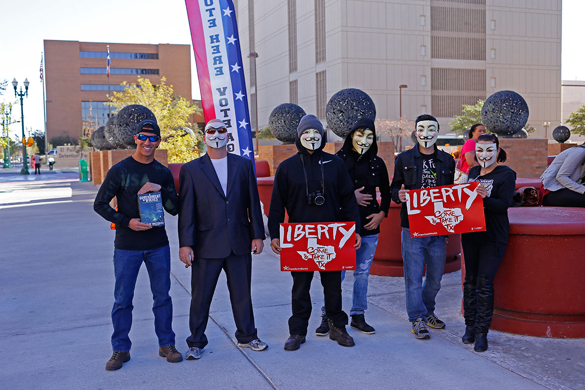 Supporters of the Million Mask March assembled in front of the El Paso county courthouse during early voting at eight a.m. (Aaron J. Montes/Borderzine.com)