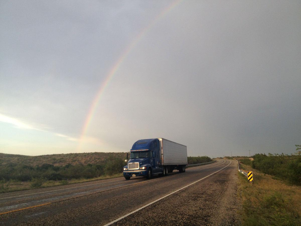 A thunderstorm offers a rainbown in the desert near Langtry. (Sergio Chapa/Borderzine.com)