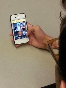 Rudy Camacho demonstrating how to use Grindr, a dating app for homosexual men. (Cristina Quinones/Borderzine.com)