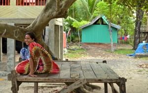 Indonesian woman outside her home in Sulawesi, Indonesia. (Valeria Hernandez/Borderzine.com)
