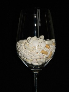pill and tablets in a glass