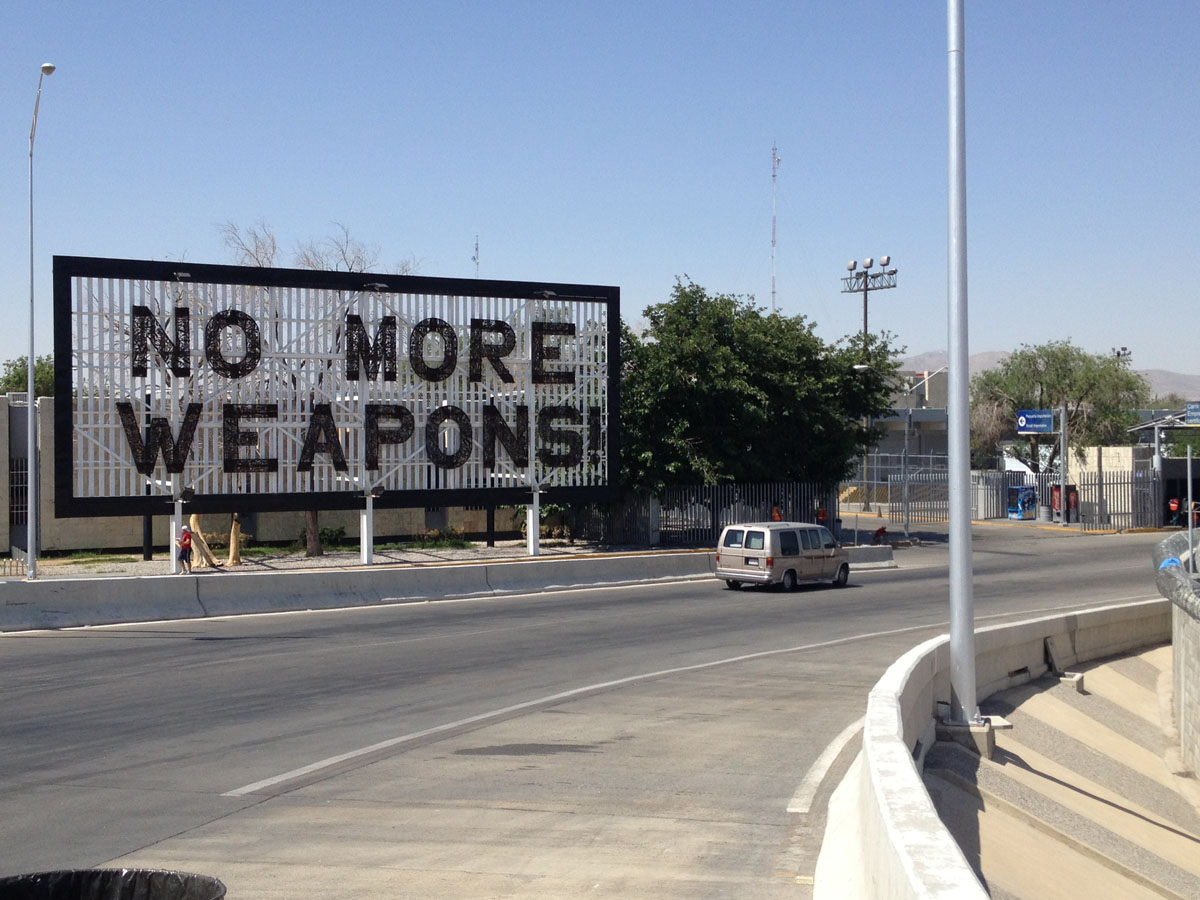 "Former Mexican President Felipe Calderon placed a ""No More Weapons"" sign at the foot of the Bridge of the Americas. (Sergio Chapa/Borderzine.com)"