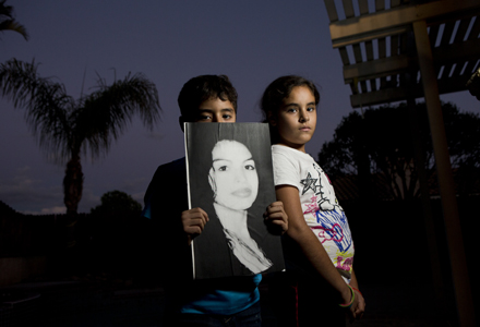 Nine-year-old twins Isaac and Rebecca Alvarado with an image of the their mother, Valeria Tachiquin-Alvarado, who was shot and killed Sept. 28, 2012, by a border agent in Chula Vista, Calif. (Nick Oza /The Republic)