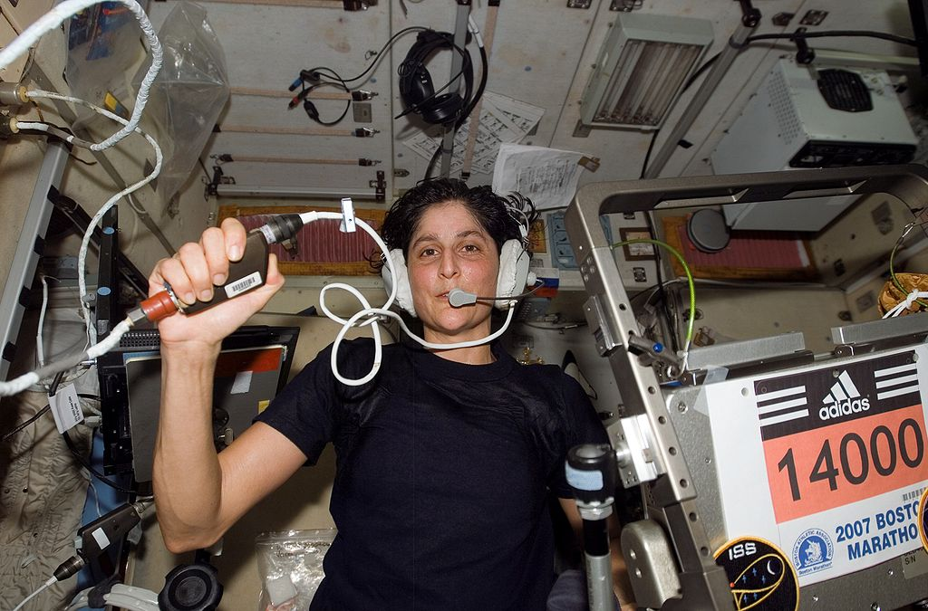 Astronaut Sunita Williams, Expedition 14 flight engineer, circled Earth almost three times as she participated in the Boston Marathon from space. She is seen here with her feet off the station treadmill on which she ultimately ran about six miles per hour while flying more than five miles each second. (NASA)