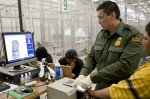 A Border Patrol agent processes individuals at a facility in Nogales, Arizona. (CBP Photography / www.flickr.com License: Creative Commons License)