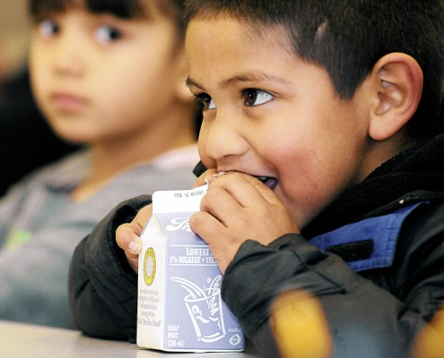 Daniel Bailon, 6, drinks his milk in a classroom at Columbus Elementary. Nearly all students at the school receive free and reduced-price breakfasts and lunches. (Robin Zielinski - Sun-News)