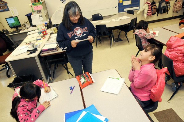 Columbus Elementary School teacher Lourdes Espinoza goes over dictation exercises with her fourth grade dual-language class. Espinoza was a Palomas student herself, crossing the U.S.-Mexico border for school each day when the agreement permitted Mexican students to attend school in New Mexico. (Robin Zielinski - Sun-News)