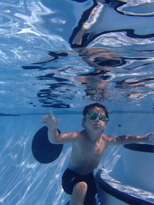 kid at swimming pool