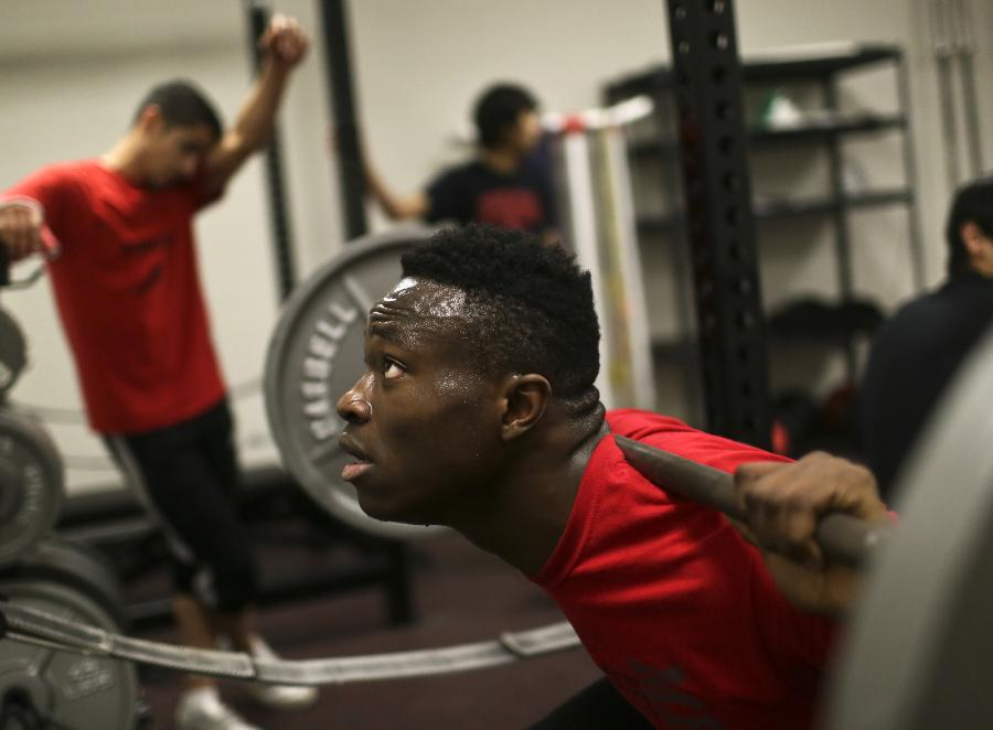 """High school senior Moise Damey, working out for his track team, is """"in limbo"""" awaiting his mother's next hearing in her bid for asylum. (David Joles/Star Tribune)"""