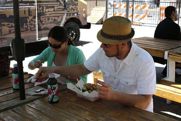 Alejandra Martinez and Leonardo Pereda eat fish tacos from the Reef Mobile Kitchen at the Foodville Truck Park in El Paso. (Laura Camden/Borderzine.com)
