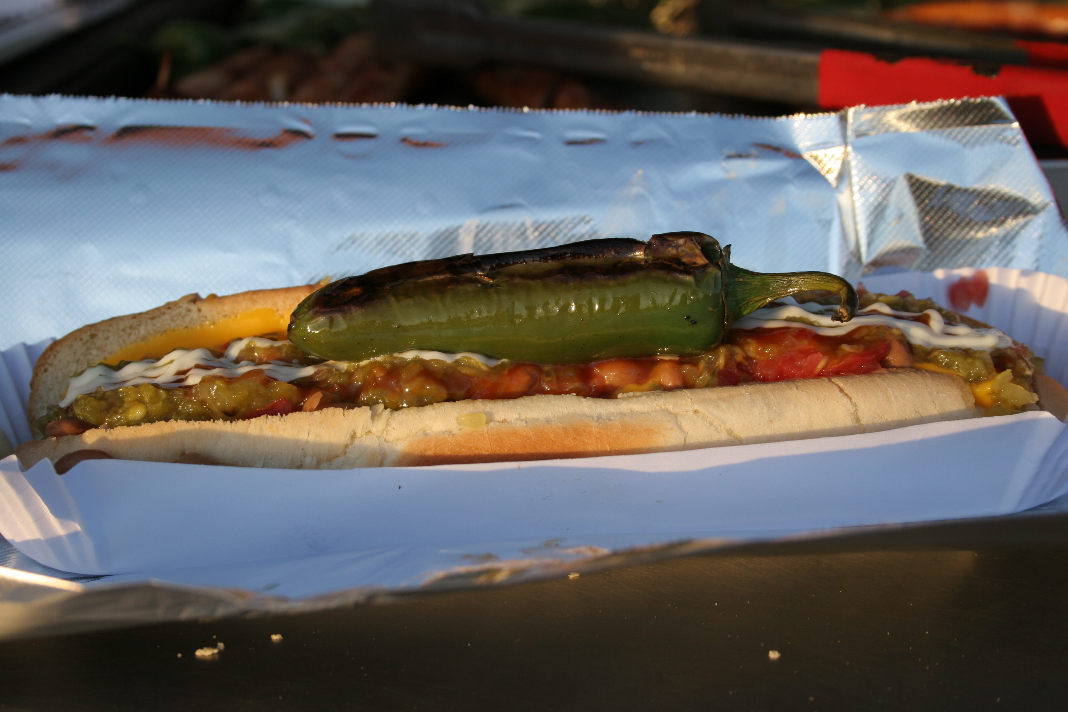 El Doggie creates authentic hot dogs with cheese, beans, chile, mustard, ketchup and mayonnaise