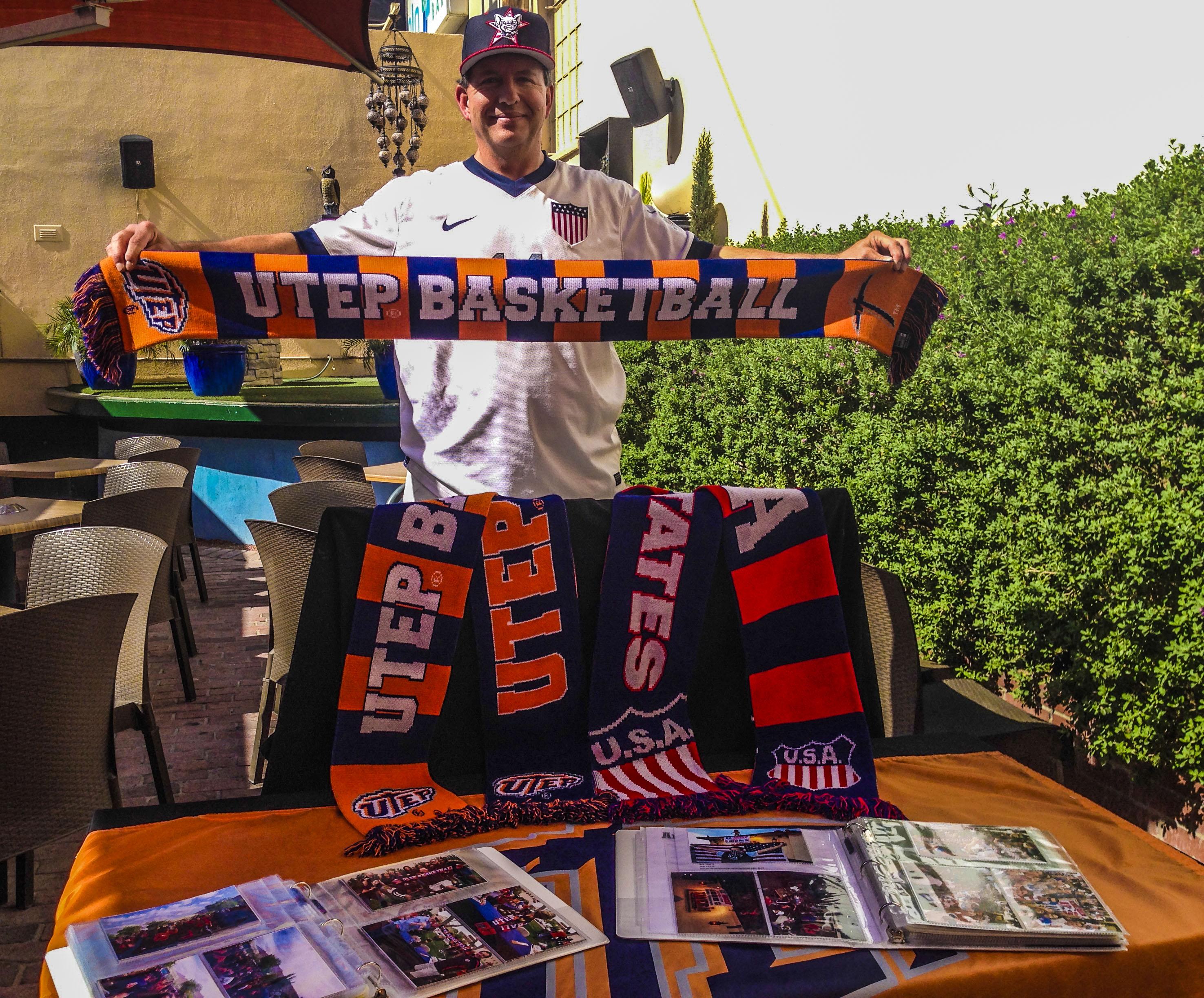 UT El Paso Super Fan Gregg Bush , who says he bleeds orange and navy, shows off his fan gear. Photo by Hector Bernal, Borderzine.com