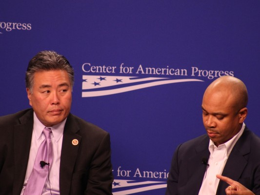 Rep. Mark Takano, D-Calif., joins Pastor Delman Coates on Wednesday at the launch of the Center for American Progress' report about LGBT discrimination. Takano and others called for new federal legislation with comprehensive protections for LGBT people. SHFWire photo by Wesley Juhl