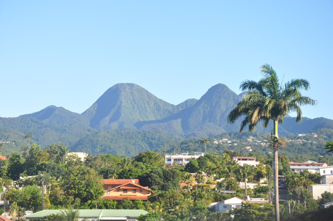 The suburbs of Fort-de-France, the capital of Martinique, with the legendary Mount Pelée looming in the distance. Photo courtesy of Stacy Marie-Luce, Tanisha Photography.