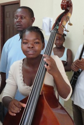 Bass student at  Occide Jeanty Music Academy in Cité Soleil, Haiti.