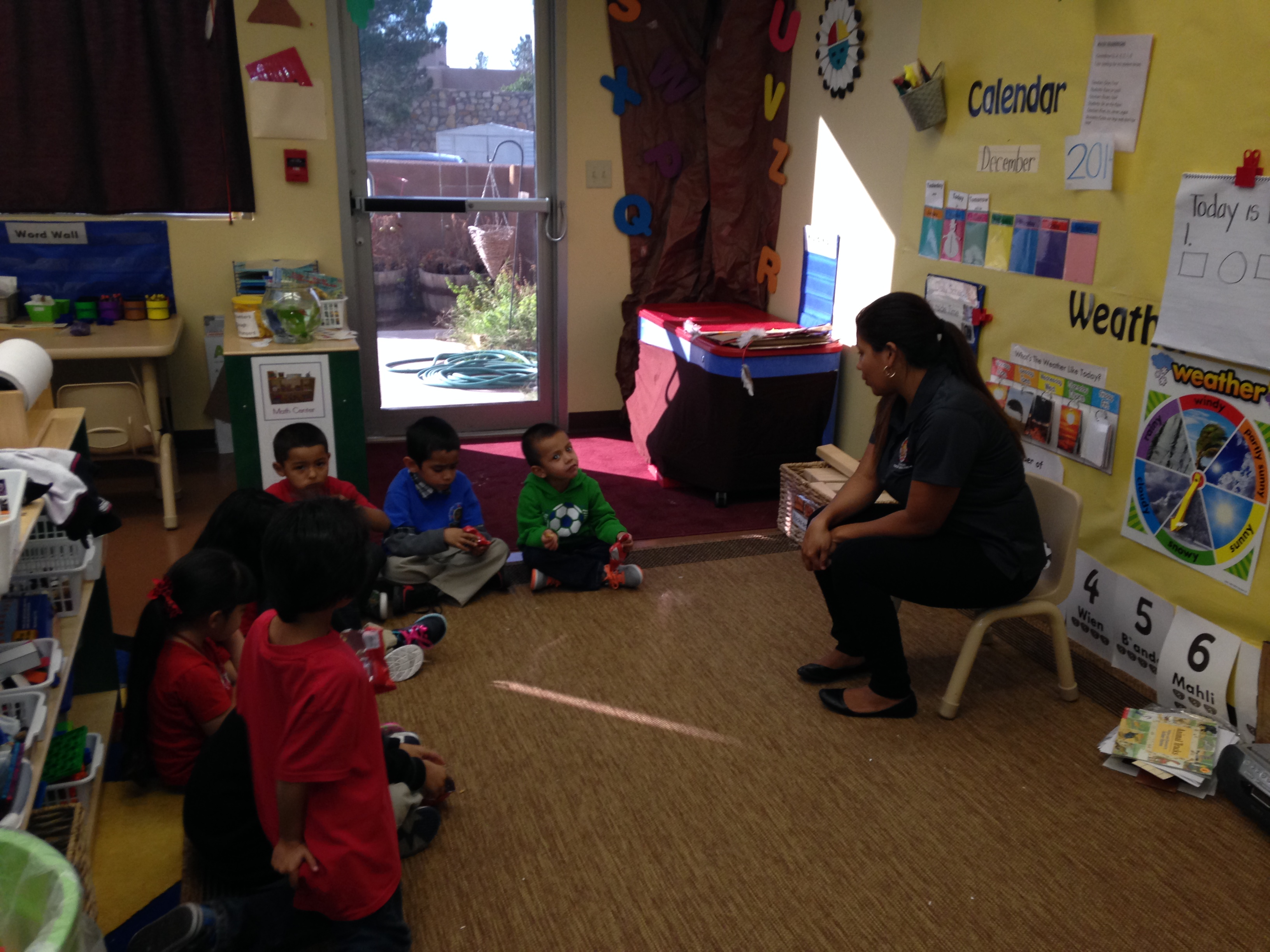Anna Silvas sits with her Pre-k students to discuss the story that was read to them. Photo credit: Jeraldine Ramos
