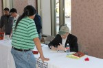 Levine signed copies of his books after a presentation to over a thousand people at UTEP. (David A. Reyes/Borderzine.com)