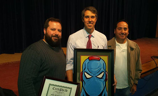 Phi3 Comics co-creators Matthew Rothblatt and Ben Perez present Congressman Beto O'Rourke a certificate and photo print of Spiralmind