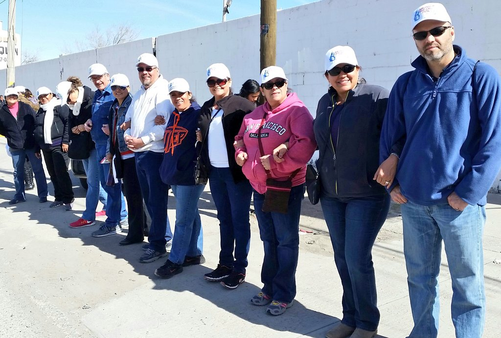 Volunteers practice linking to form human wall for pope's visit