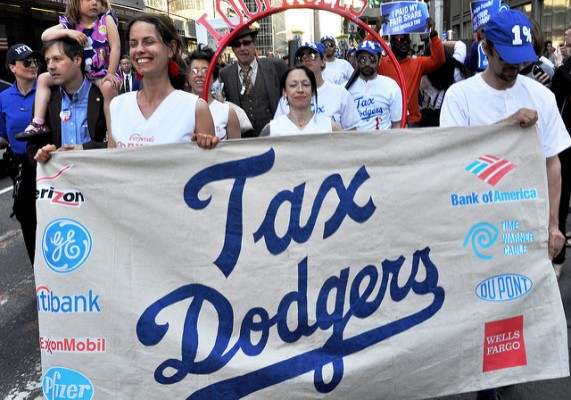 "The Tax Dodgers, the Corporate Loophole cheerleaders and ""Mitt"" the dancing baseball glove greet Ann Romney at Trump Tower in midtown Manhattan in 2012 and join the march."