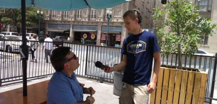 Journalism in July alum from 2013, Kynan Marlin, reporting for an assignment in the field