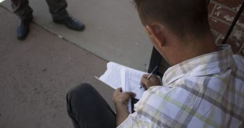 A newly arrived Cuban migrant fills out paperwork in El Paso.