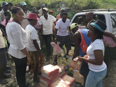 Duquesne Dimanche of Miami distributes food and tarps in the village of Anadere, Haiti following Hurricane Matthew.