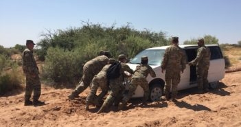 Soldiers work to get a vehicle out of the sand during a recent training exercise at Fort Bliss Army post. Photo by Elizabeth Vega for Borderzine.com