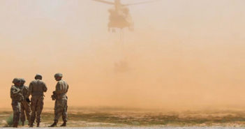 A group of soldiers wait their turn to train with the sling operation helicopter. Photo credit: Claudia Garcia