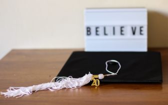 Graduating cap with a '20 tassel hanging on its side.