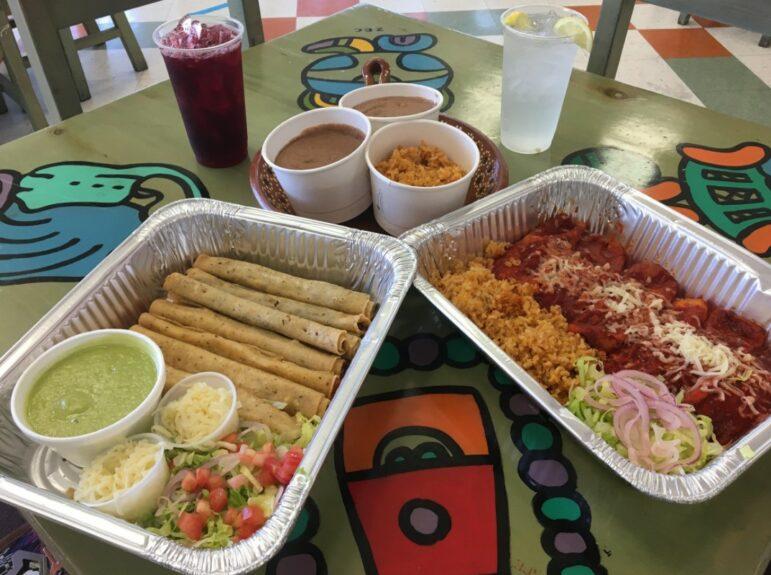 Trays of enchiladas and flautas