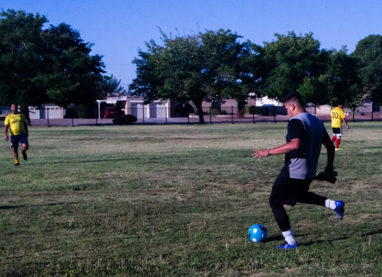 Dynamo goalkeeper Frank Rodriguez, 23, sets the soccer ball to kick it to his teammate as they warm up before the game.