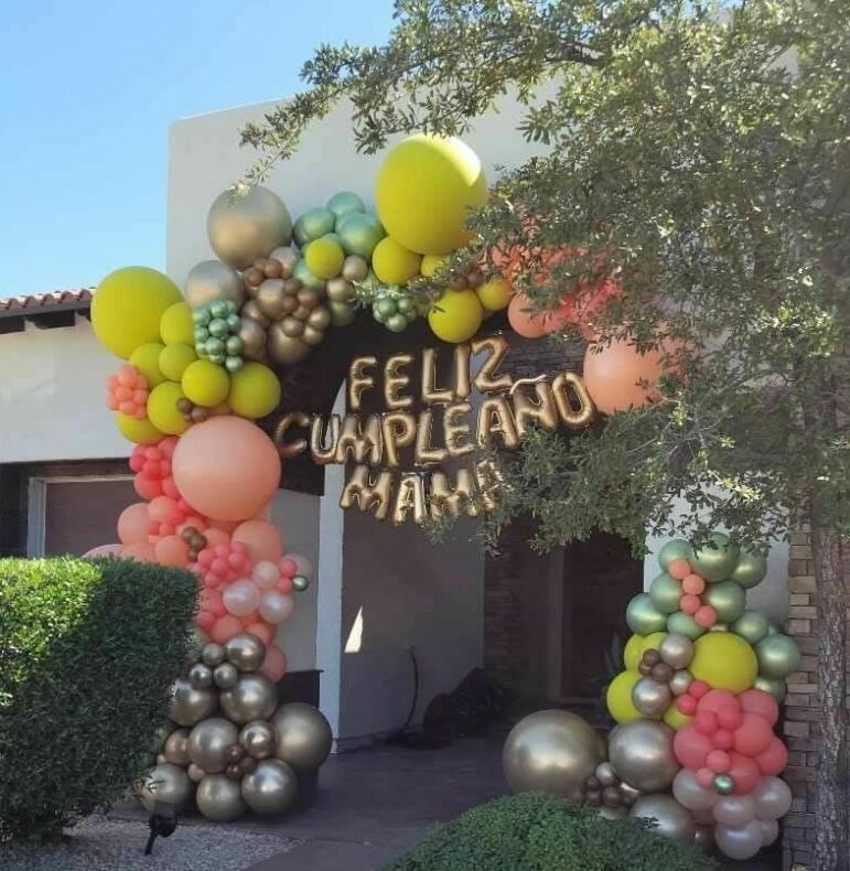 El Pasoan family sends love and balloon garland to celebrate their mother's birthday though front entrance.